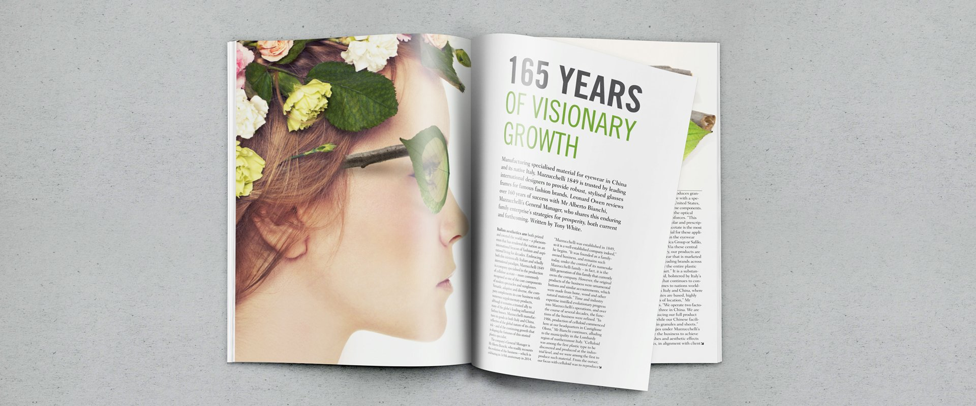 Publication layout design for an eyewear company showing a woman wearing 'natural' glasses and using clean bold typography.